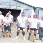 Uprostred s pohárom staronový šampión František Piros, po ľavici strieborný Marek Tóth, po pravici bronzový Patrik Zelezka, celkom vpravo prezident SASIM Milan Gabrhel